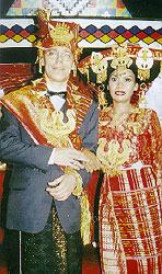 Heinz Kathmann and Rose Merry Ginting in traditional Batak Karo wedding dress